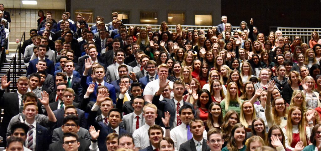 Missionaries return a wave to Elder D. Todd Christofferson following the Christmas Day devotional at the Provo Missionary Training Center on Dec. 25, 2019, in Provo, Utah.