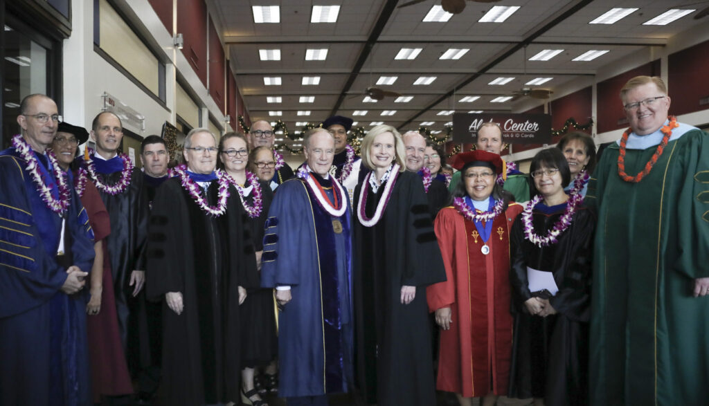 Sister Bonnie H. Cordon, Young Women general president, center right, andPresident John S. Tanner, president of BYU-Hawaii, center left, pose for a photo with faculty following the 2019 fall commencement ceremony in Laie, Hawaii on Dec. 13, 2019.