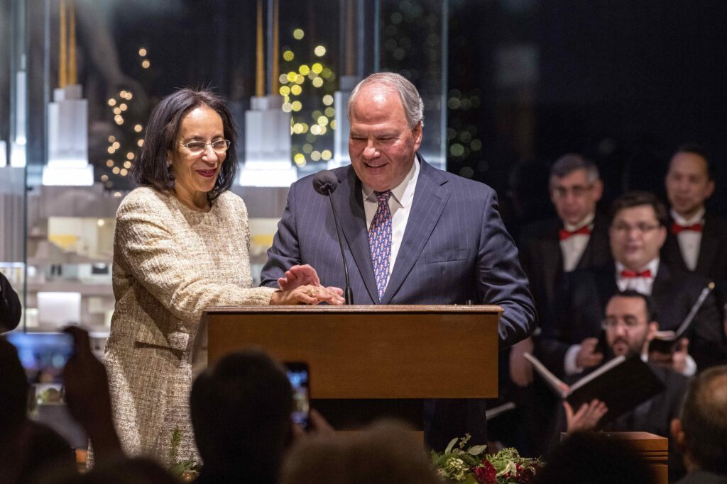 Elder Ronald A. Rasband of the Quorum of the Twelve Apostles, right, and Her Excellency Hunaina Al Mughairy, ambassador of the Sultanate of Oman, left, press the switch that illuminated more than 400,000 lights around the Washington D.C. Temple Visitors' Center on Tuesday, Dec. 3, 2019.