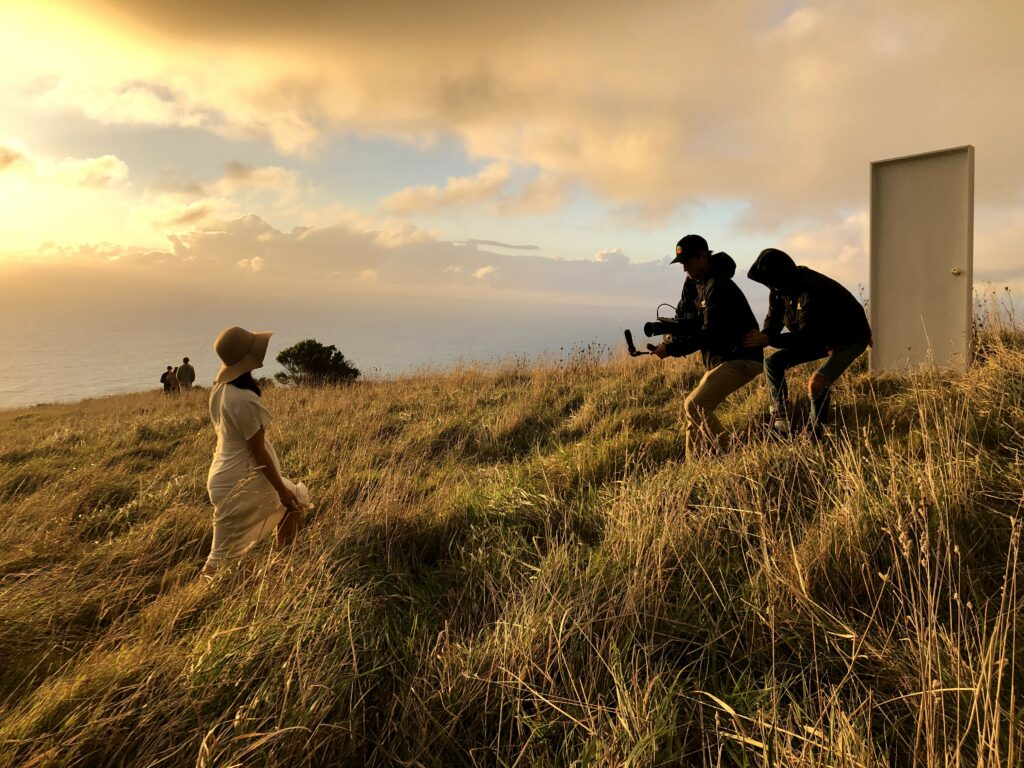 To create the 2020 youth theme video, four Latter-day Saint youth, accompanied by a film crew and production team from Church headquarters, spent two weeks carrying a full-size door throughout New Zealand—not only through airports but up rocky mountains, through fields of swaying grass, and across black-sand beaches.