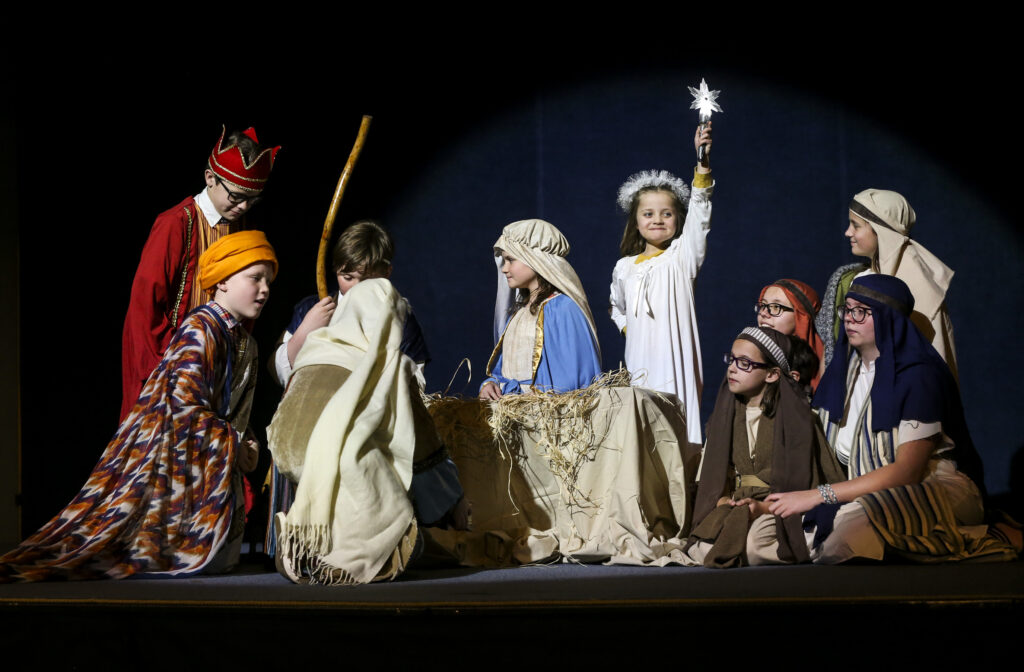 Children portray the three wise men delivering gifts to the baby Jesus during a reenactment of the birth of Jesus Christ during the annual Christmas Eve Nativity Program at the Provo Missionary Training Center in Provo, Utah on Tuesday, Dec. 24, 2019.