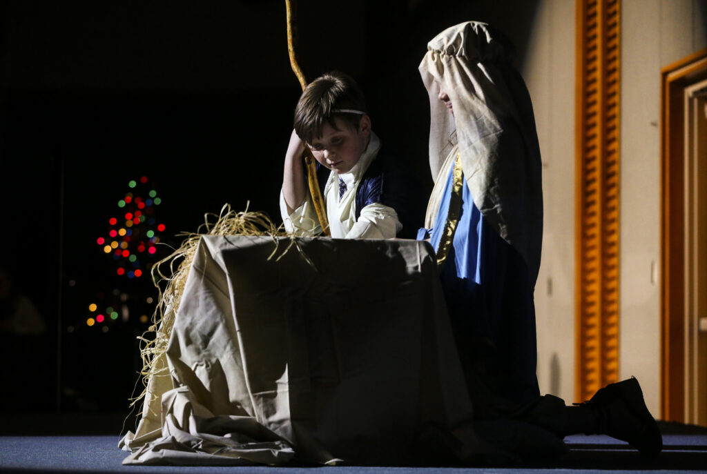 Children act the parts of Joseph and Mary during the story of the birth of Jesus Christ during the annual Christmas Eve Nativity Program at the Provo Missionary Training Center in Provo, Utah, on Tuesday, Dec. 24, 2019.