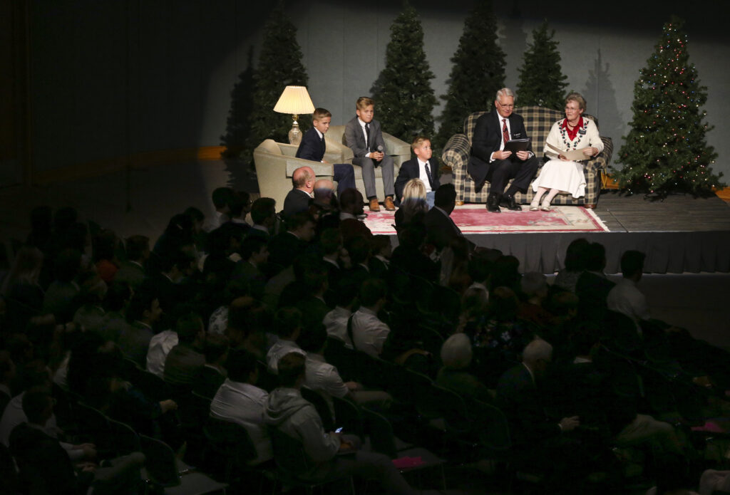 Sister Nancy LeSueur, right, and President David E. LeSueur and three of their grandchildren welcome guests during the annual Christmas Eve Nativity Program at the Provo Missionary Training Center in Provo, Utah, on Tuesday, Dec. 24, 2019.