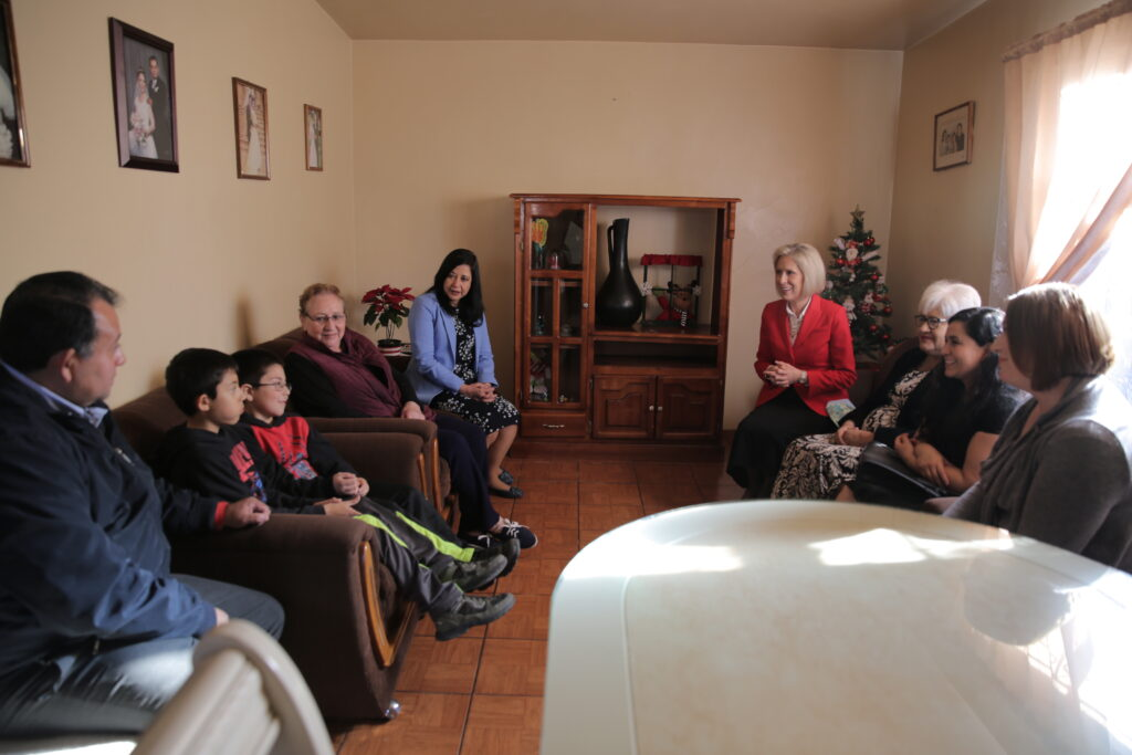 Sister Joy D. Jones speaks with a family in the Mexico Area during a ministering visit in December 2019.