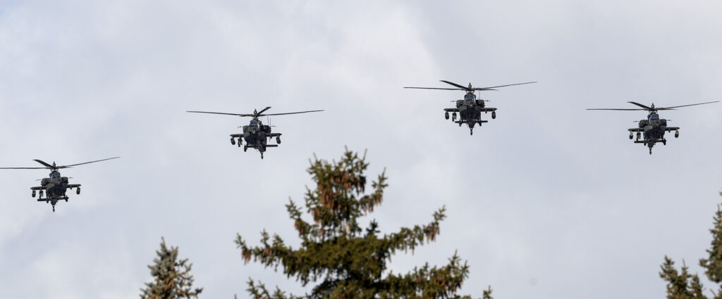 Apache helicopters fly over graveside services for Chief Warrant Officer 2 Kirk T. Fuchigami Jr. at the Brigham City Cemetery on Monday, Dec. 9, 2019. Fuchigami and his co-pilot died when their helicopter crashed as they provided security for troops on the ground in Logar Province in eastern Afghanistan.