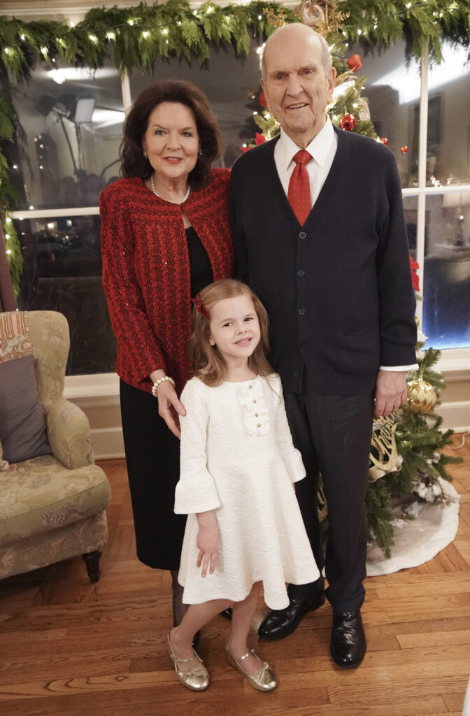 President Russell M. Nelson of The Church of Jesus Christ of Latter-day Saints and his wife Sister Wendy Nelson pose with Claire Crosby in Salt Lake City on Dec 6, 2019.