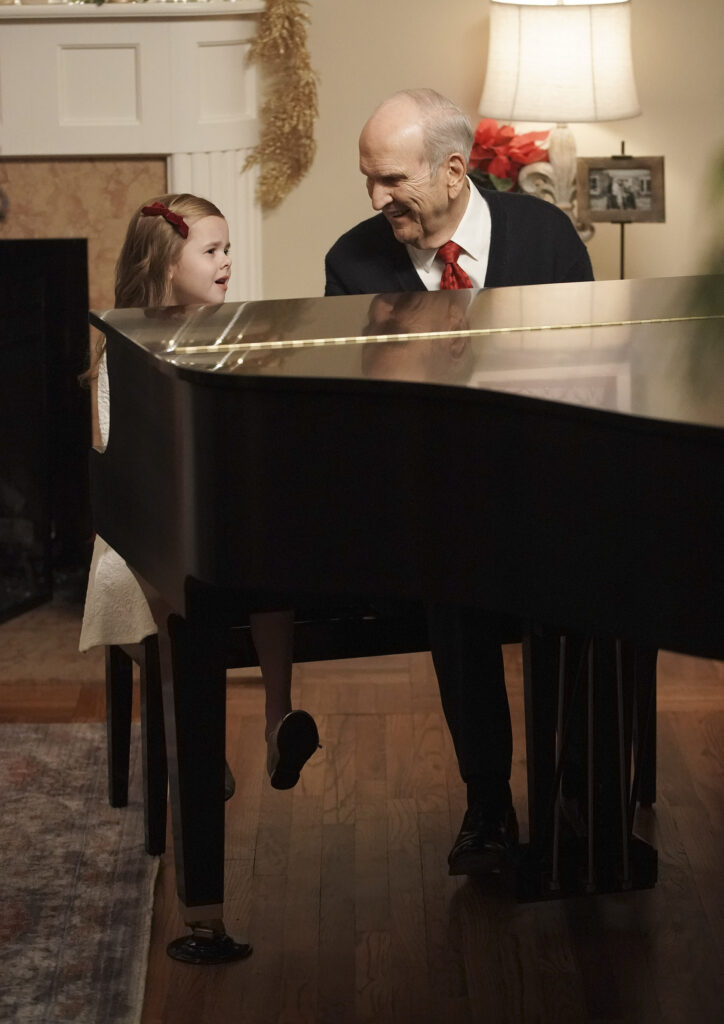 President Russell M. Nelson of The Church of Jesus Christ of Latter-day Saints plays the piano while Claire Crosby sings in Salt Lake City on Dec 6, 2019.