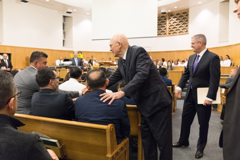 President Dallin H. Oaks, first counselor in the First Presidency, greets Spanish-speaking Latter-day Saints from eight stakes in Chicago before a devotional in the Wilmette Illinois Stake center on Nov. 23, 2019.