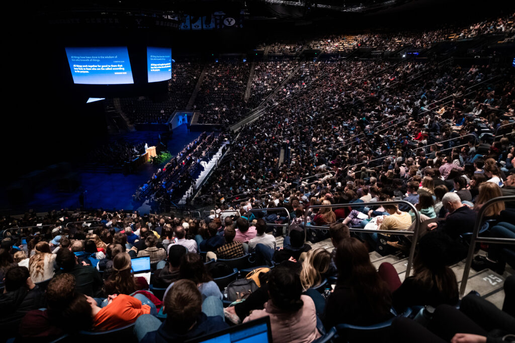 BYU students seated in the Marriott Center listen to a devotional by Elder Michael T. Ringwood on Tuesday, Jan. 14, 2020.