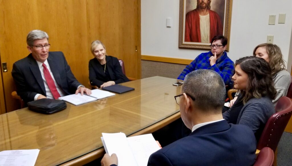 Elder S. Gifford Nielsen and Sister Wendy Nielsen meet with President and Sister Keung of the Canada Calgary Mission and several missionary leaders on Oct 30, 2019, in Calgary, Canada, prior to beginning a mission tour.