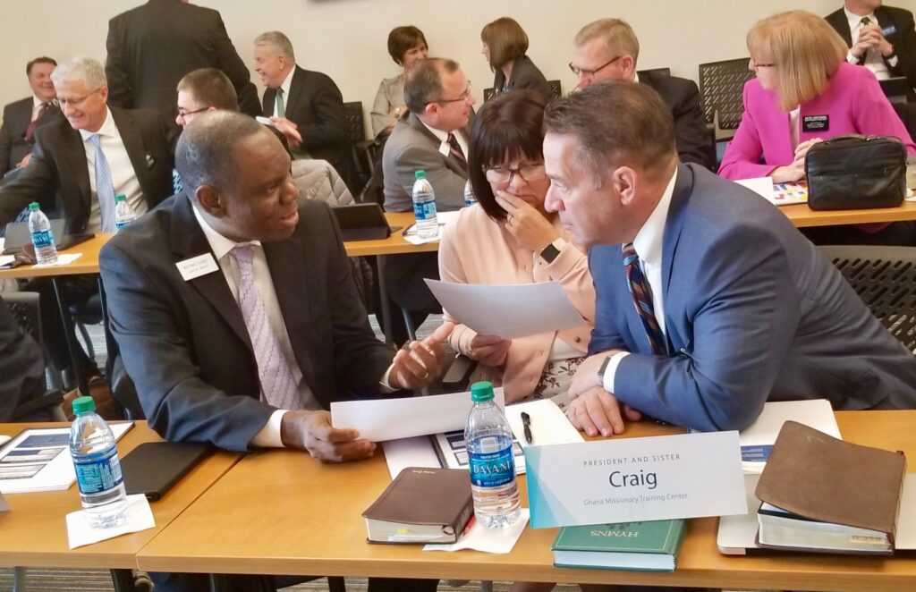 President Paul W. Craig, right, and Sister Nadine Craig, new president and companion for the Ghana Missionary Training Center, review schedules with Mathias Eguko, the Ghana MTC's manager of operations, during the 2020 MTC Leadership Seminar Jan. 14, 2020, at the Provo MTC in Provo, Utah.