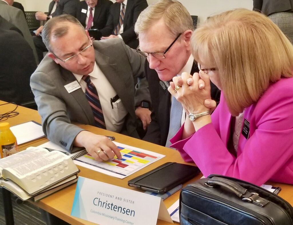 President Roger G. Christensen and Sister Christine C. Christensen, right, new president and companion of the Colombia Missionary Training Center, review schedules with John Gallego, left, the Colombia MTC's manager of operations, during the 2020 MTC Leadership Seminar Jan. 14, 2020, at the Provo MTC in Provo, Utah.