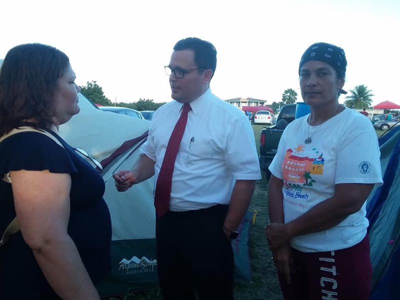 On. Jan. 9, 2020, Elder Jorge M. Alvarado visits with people in southern Puerto Rico gathered in an open space being utilized as a tent community following a series of earthquakes.