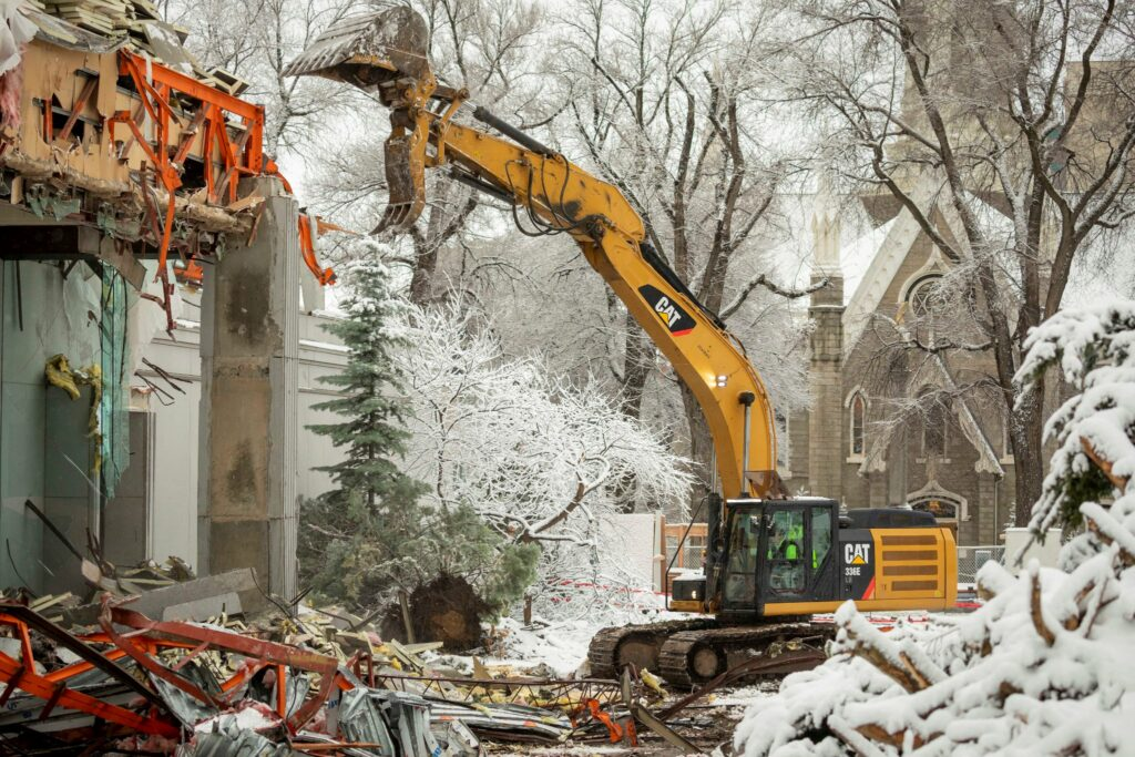 The Temple Square South Visitors' Center and portions of the square's south wall are being demolished to give construction crews access to excavate around the Salt Lake Temple for a major renovation, Friday, Jan. 17, 2020.
