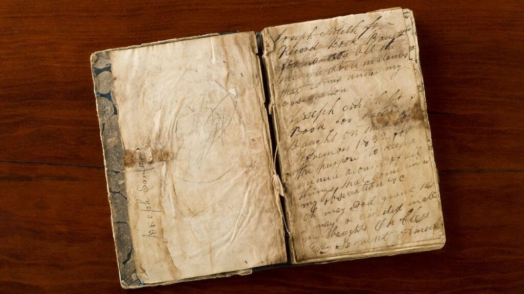 """A photo of Joseph Smith's 1832 journal where he recounted his First Vision to Robert Matthews, a visitor to Kirtland, Ohio. The journal and other artifacts related to accounts of the First Vision are on display at the Church History Library exhibit """"Foundations of Faith."""""""