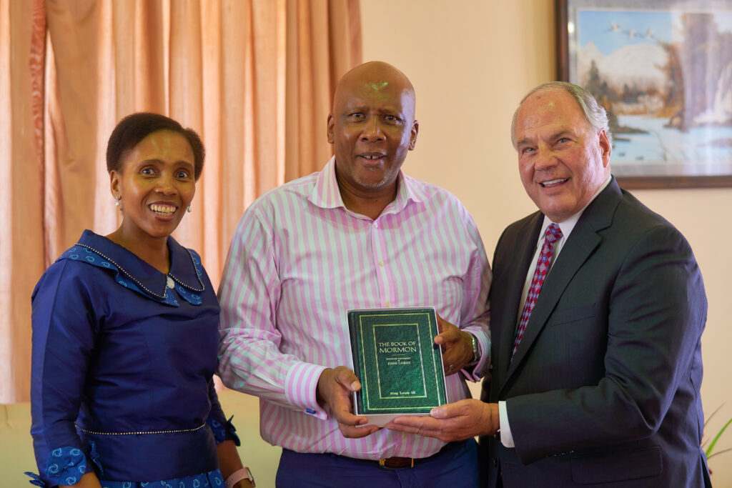 Elder Ronald A. Rasband of the Quorum of the Twelve Apostles presents a Book of Mormon to Lesotho's King Letsie III and Queen 'Masenate Mohato Seeiso at the royal palace in Maseru on Monday, Feb. 10, 2020.
