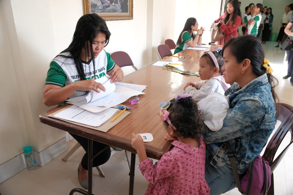 Members of the Toledo Philippines District register participants in a child malnutrition screening hosted by the district on Feb. 8, 2020.
