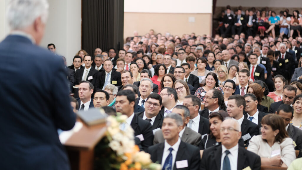 An audience of priesthood and women leaders enjoy listening to instruction from Elder Dieter F. Uchtdorf at a stake center in Montevideo, Uruguay.