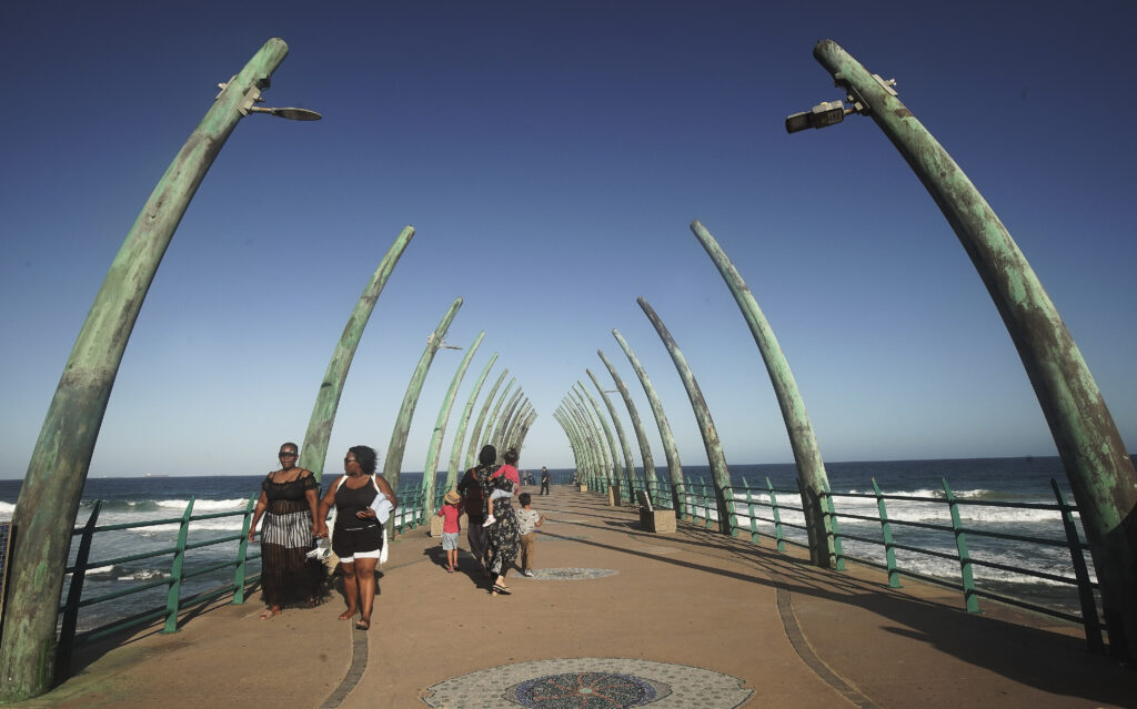 People walk on the pier in Umhlanga, South Africa, on on Feb. 13, 2020.