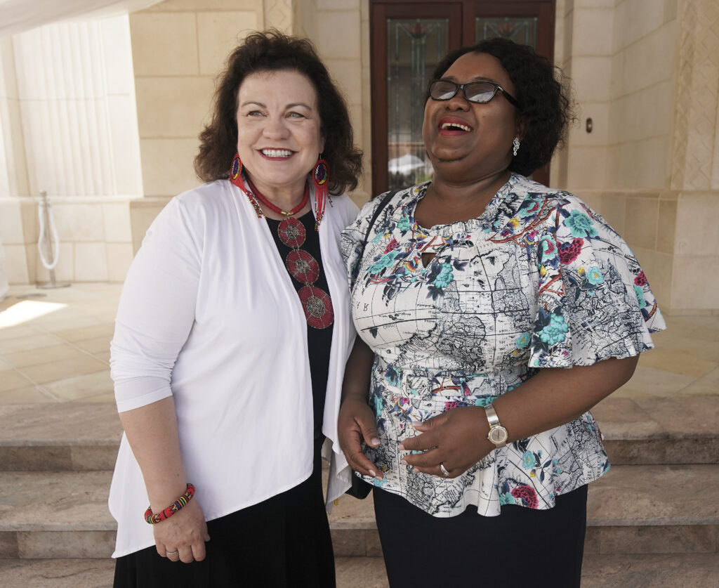 Sister Melanie Rasband laughs with Her Majesty, Queen Mchiza, wife of Zulu nation King Goodwill Zwelithini kaBhekuzulu, during a tour of the Durban South Africa Temple in Umhlanga, South Africa, on Saturday, Feb. 15, 2020.