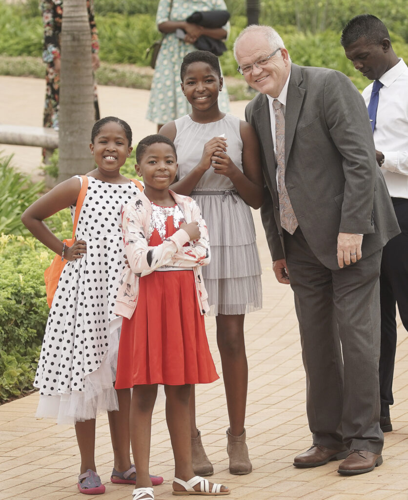 Church News managing editor Scott Taylor pauses with Vuyo Tyukwana, Monica Makhatini and Iya Makhatini outside the Durban South Africa Temple prior to its dedication in Umhlanga, South Africa, on Sunday, Feb. 16, 2020.