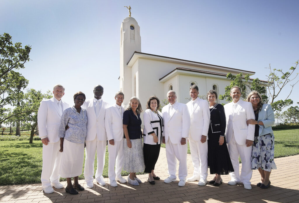 Elder Ronald A. Rasband, of The Church of Jesus Christ of Latter-day Saints' Quorum of the Twelve Apostles, and Sister Melanie Rasband and others pose between sessions of the Durban South Africa Temple dedication in Umhlanga, South Africa, on Sunday, Feb. 16, 2020. From left: Elder Kevin R. Duncan, Sister Gladys Sitati, Elder Joseph W. Sitati, Elder S. Mark Palmer, Sister Jacqueline Palmer, Sister Melanie Rasband, Elder Ronald A. Rasband, Elder Carl B. Cook, Sister Lynette Cook, Elder Joni L. Koch and Sister Michelle Koch.