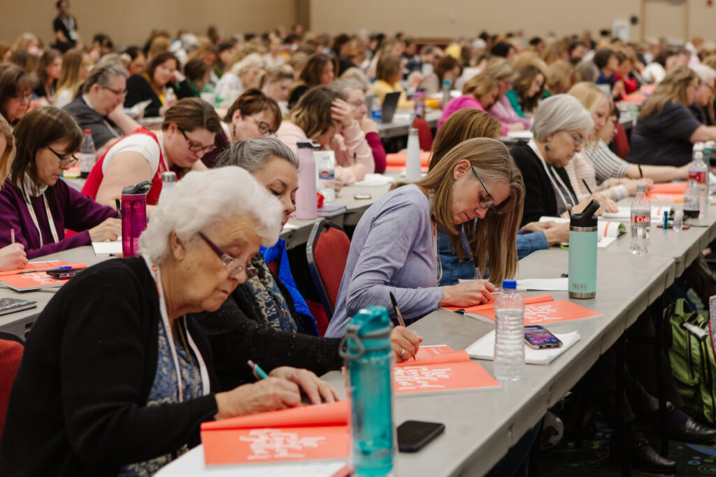 Attendees take notes duringLight Keepers, a RootsTech event for Latter-day Saint women at the Salt Palace Convention Center in Salt Lake City on Feb. 28, 2020.