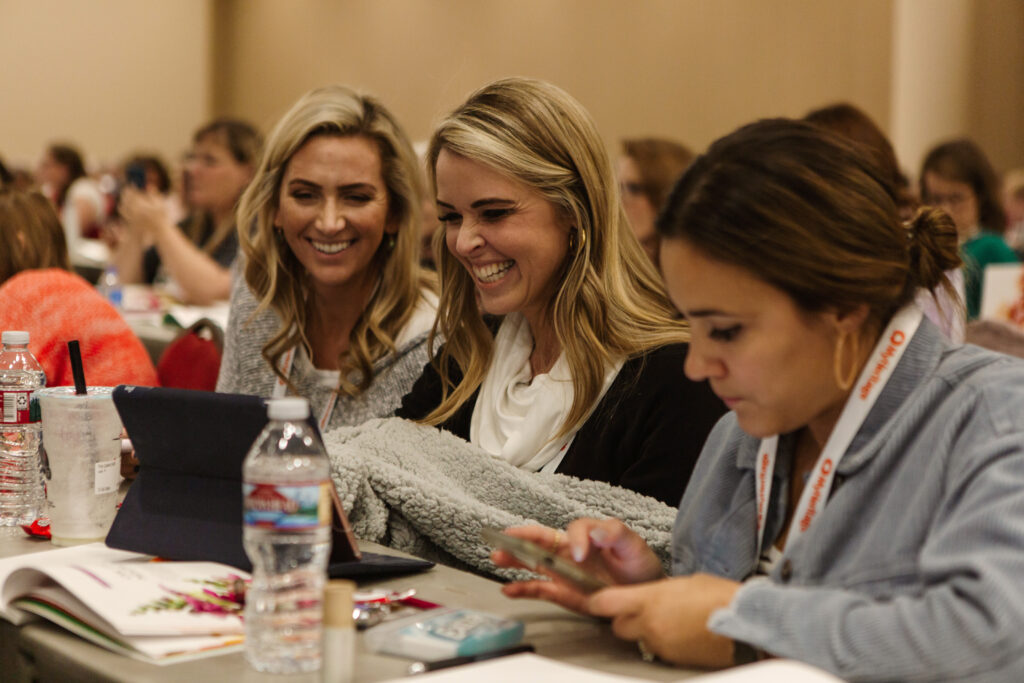 Attendees smile duringLight Keepers, a RootsTech event for Latter-day Saint women at the Salt Palace Convention Center in Salt Lake City on Feb. 28, 2020.