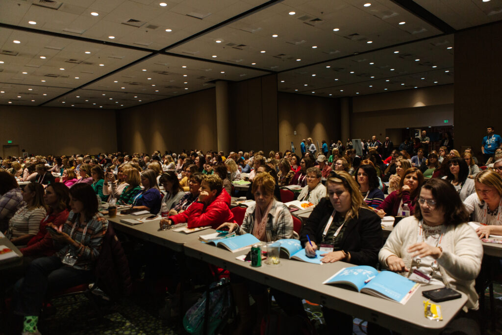Attendees participate during Light Keepers, a RootsTech event for Latter-day Saint women at the Salt Palace Convention Center in Salt Lake City on Feb. 28, 2020.