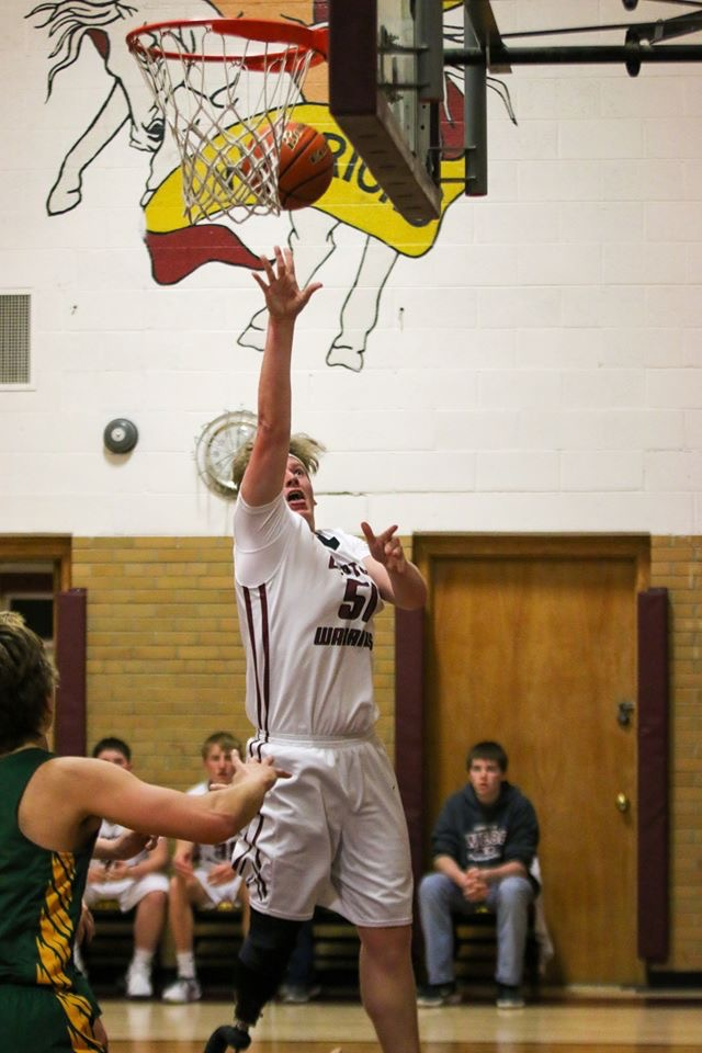 Drew Haley scores two of his 26 points during a recent game at Layten High School in Nebraska.
