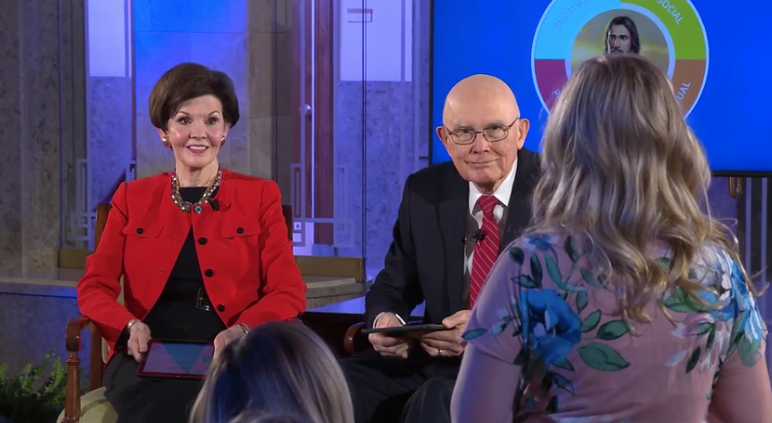 President Dallin H. Oaks and his wife, Sister Kristen Oaks, listen to a young woman talk about her experience so far in the Children and Youth program during a Face to Face event on Feb. 23, 2020.
