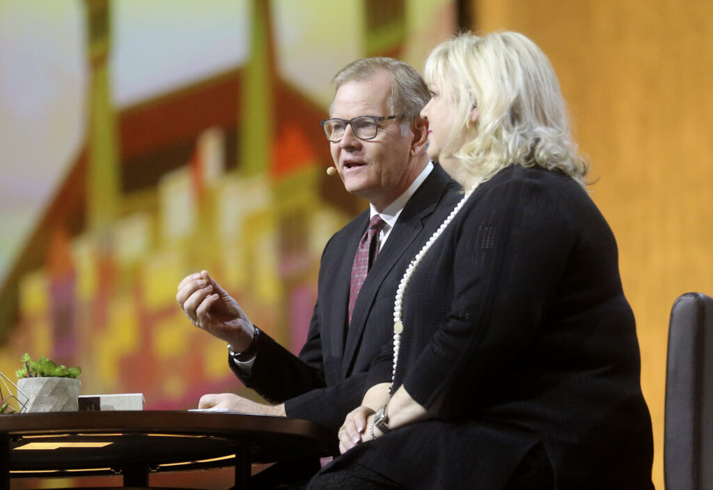 Elder Gary E. Stevenson of the Quorum of the Twelve Apostles of The Church of Jesus Christ of Latter-day Saints and his wife, Sister Lesa Stevenson, speak during RootsTech at the Salt Palace Convention Center in Salt Lake City on Saturday, Feb. 29, 2020.
