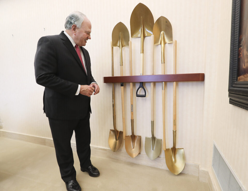 Elder Ronald A. Rasband, of The Church of Jesus Christ of Latter-day Saints' Quorum of the Twelve Apostles, looks over his groundbreaking shovels at his office in Salt Lake City on Wednesday, Feb. 5, 2020, as he talks about his history participating in temple groundbreakings and dedications.