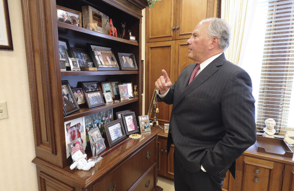 Elder Ronald A. Rasband, of The Church of Jesus Christ of Latter-day Saints' Quorum of the Twelve Apostles, looks over photos at his office in Salt Lake City on Wednesday, Feb. 5, 2020, as he talks about his history participating in temple groundbreakings and dedications.