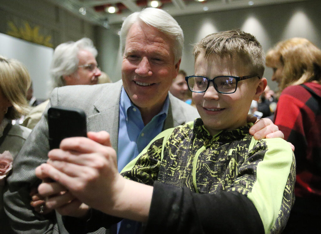 Brother Stephen W. Owen, Young Men general president, takes a selfie with Quinlan Hart as the Young Men and Young Women general presidencies attended the RootsTech youth night at the Salt Palace in Salt Lake City on Wednesday, Feb. 26, 2020.