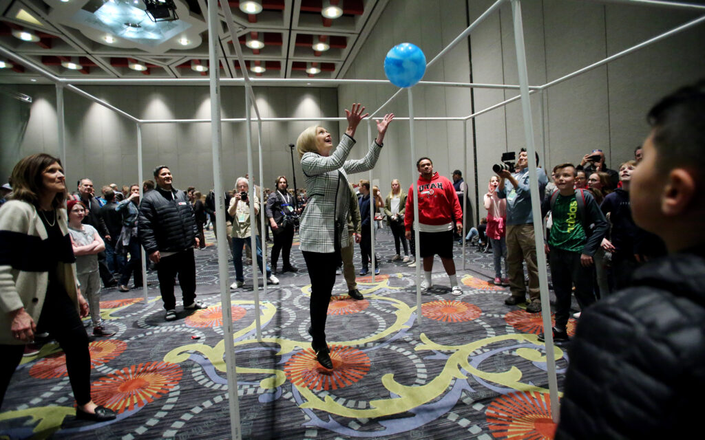 Sister Bonnie H. Cordon, Young Women general president, hits the ball during a game of 9-square as the Young Women and Young Men general presidencies attend the RootsTech youth night at the Salt Palace in Salt Lake City on Wednesday, Feb. 26, 2020.