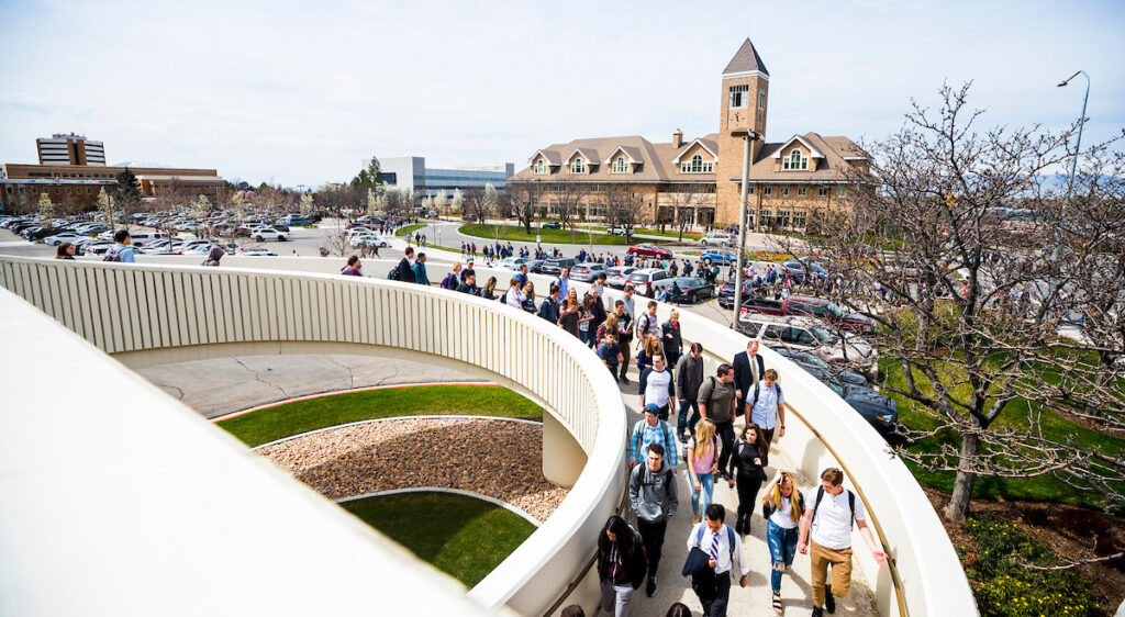Students walk on the BYU campus after a campus devotional on April 10, 2018.