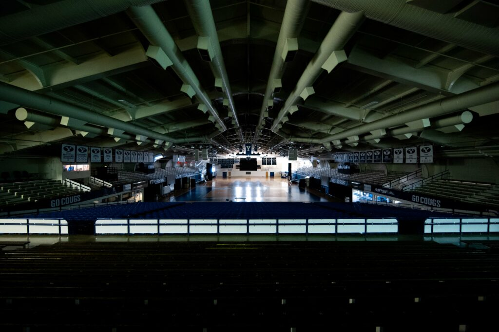 An empty, dimly lit Smith Fieldhouse reflects the impact of the 2020 coronavirus pandemic on the BYU campus.