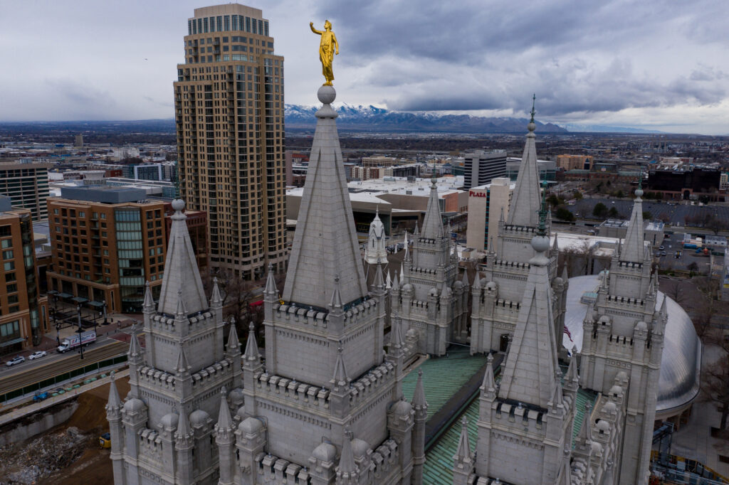 The Angel Moroni statue atop the Salt Lake Temple of The Church of Jesus Christ of Latter-day Saints stands with its trumpet missing after a 5.7 magnitude earthquake centered in Magna hit on Wednesday, March 18, 2020.