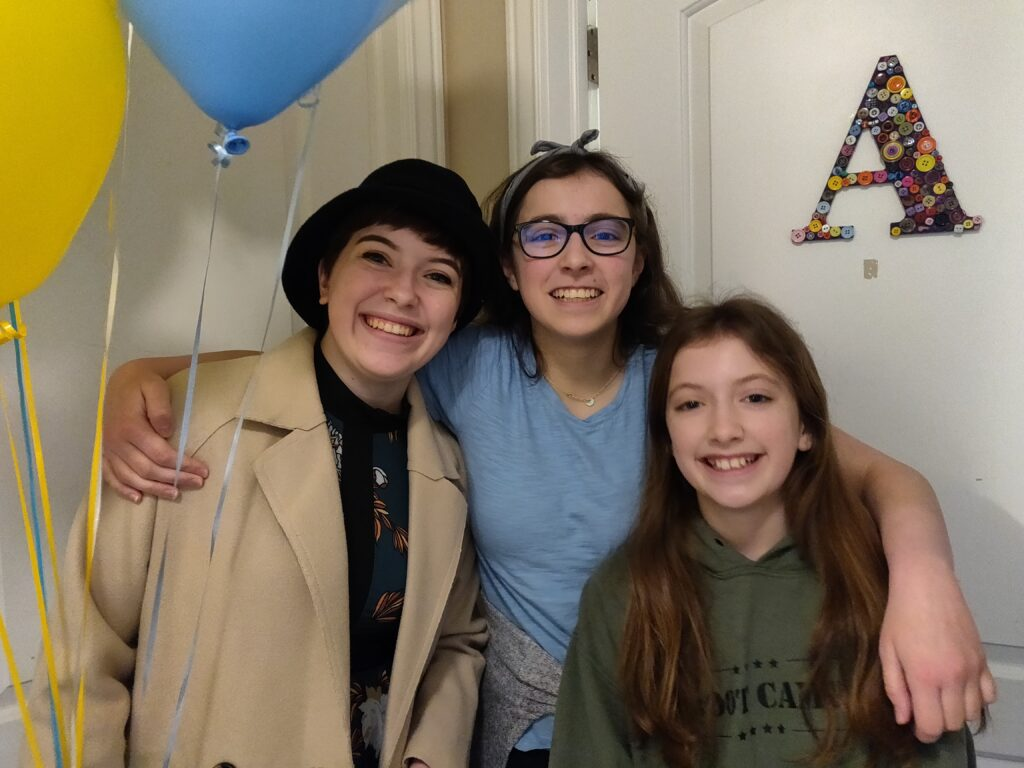"Sister Aubrey Arnold, left, gets dropped off at her ""MTC"" — her room in the Arnold home in Eagle Mountain, Utah — by her sisters Annie, center, and Paige, right, on March 25, 2020, as a new missionary training to serve in the Nevada Las Vegas West Mission."