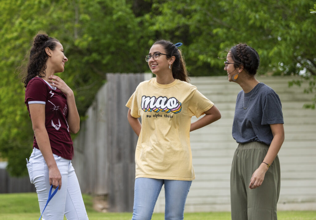Members of the Funke family chat outside near their home in Houston, Texas.