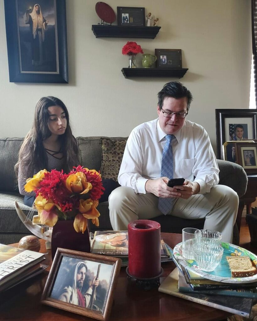 Michael Brock and his daughter, Jessica, prepare for the sacrament in their home in Henderson, Nevada, on March 15, 2020. Traditional gatherings were cancelled because of the coronavirus pandemic.