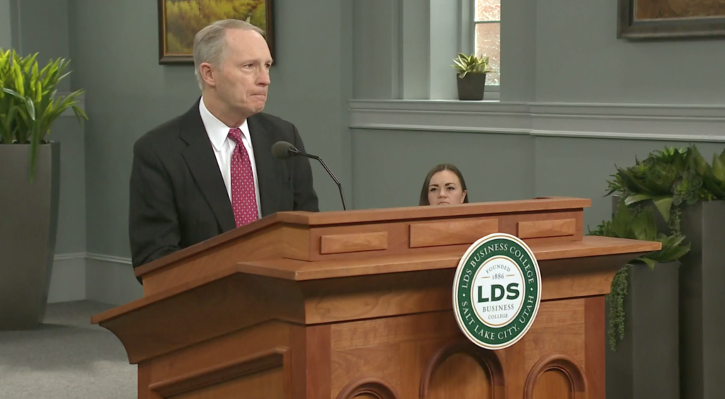 President Bruce C. Kusch speaks at an LDS Business College devotional Tuesday, March 17. The devotional was livestreamed because of the ongoing COVID-19 pandemic.