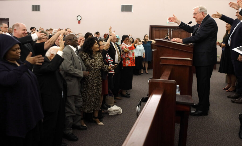 President M. Russell Ballard, acting president of the Quorum of the Twelve Apostles of The Church of Jesus Christ of Latter-day Saints, exchanges air-handshakes with the congregation after speaking at the Brampton Stake Center in Brampton, Ontario, Canada, March 8, 2020.