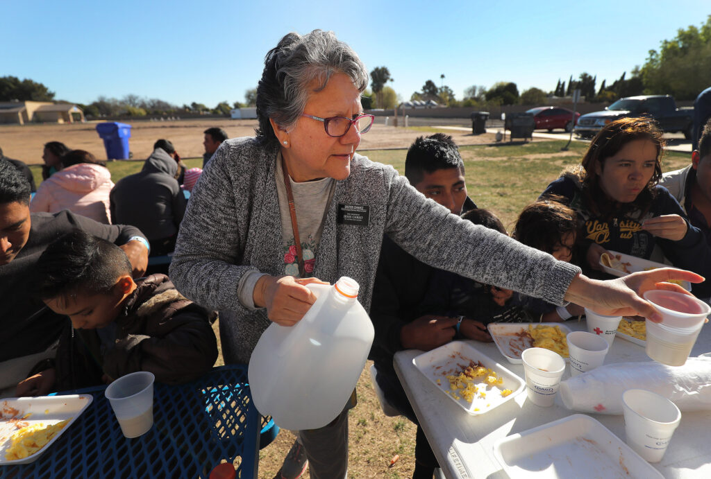 Sister Norma Chavez, service missionary with The Church of Jesus Christ of Latter-day Saints, serves breakfast to refugees at a metropolitan area church in Phoenix, Arizona on Monday, Feb 11, 2019.