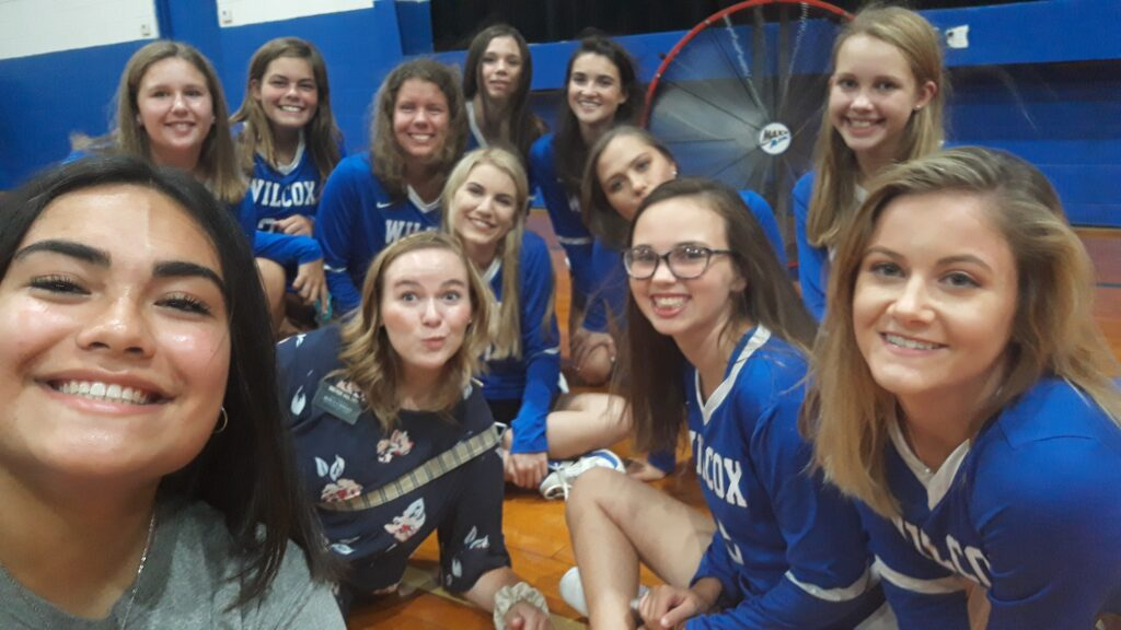 Sister Megan Sintay, left, and her companion, Sister Holtry, smile with the Wilcox Academy girls' volleyball team.