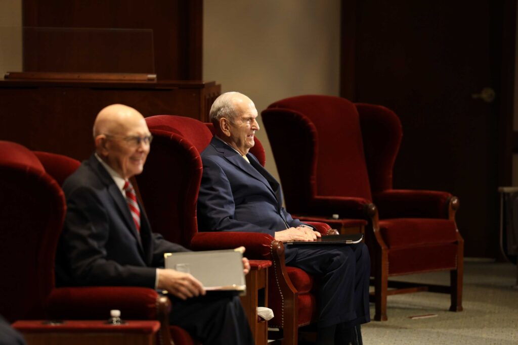 President Russell M. Nelson (right) and President Dallin H. Oaks (left) are seated in a small auditorium in the Church Office Building for the morning session of general conference, April 4, 2020.