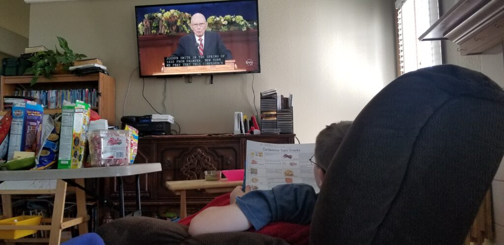 Daniel Feickert, 12, of the Chapel Hills Ward, Colorado Springs East Stake watches the Saturday morning session of the 190th Annual General Conference on April 4, 2020.