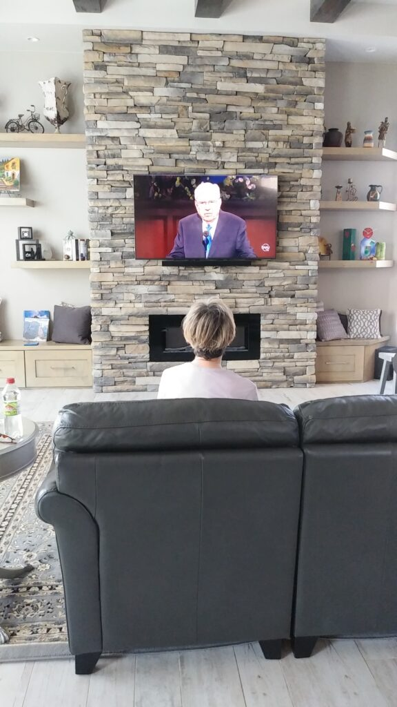 "Debra Moss of the Red Cliffs 6th Ward, St George Utah Red Cliffs Stake, watches President M. Russell Ballard speak during the Saturday morning session of the 190th Annual General Conference on April 4, 2020. ""I am feeling especially grateful for the feeling that the truth of the Lord is going forth in this conference despite what is happening in the world and when it seems our lives have been put on hold,"" Moss wrote."