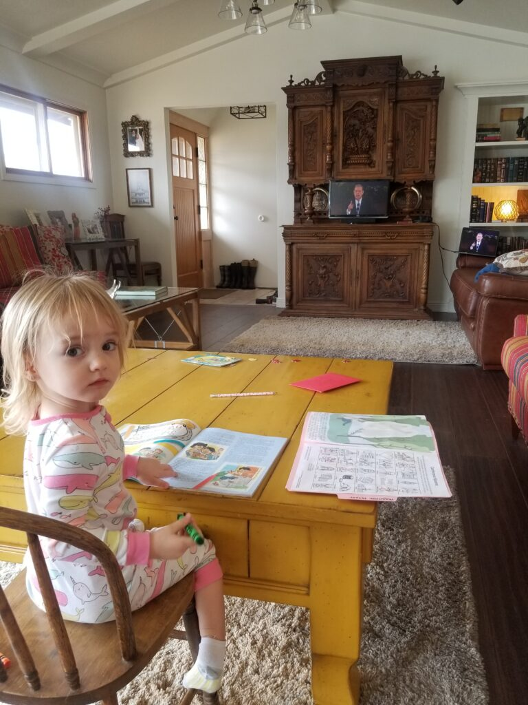 Roy and Janelle Fetzer's 2-year-old daughter Madeleine Fetzer of the Soda Springs 3rd Ward, Soda Springs Idaho Stake, watches the Sunday morning session of the 190th Annual General Conference on April 5, 2020